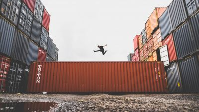 Man jumping on a shipping container